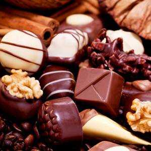 collection of different sweet chocolate pralines closeup background present sugar